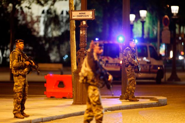 Armed soldiers secure the Champs Elysees Avenue after a policeman was killed and two others were wounded in a shooting incident in Paris, France, April 20, 2017. REUTERS/Benoit Tessier
