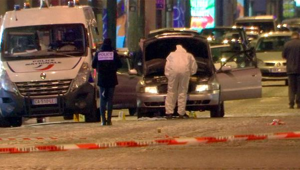 A still image from video footage shows Police investigators inspect the car used by the attacker on the Champs Elysees Avenue after two policemen were killed and another wounded in a shooting incident in Paris, France, April 20, 2017. REUTERS/Reuters Tv