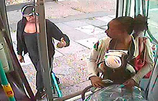 Undated handout CCTV still issued by the Metropolitan Police of Rosalin Baker being given the thumbs up by Jeffrey Wiltshire as she boards a bus, as the pair are facing jail over the death of their premature baby who was found lifeless on a bus. Metropolitan Police/PA Wire