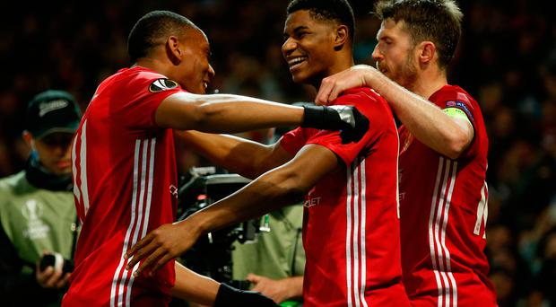 Manchester United's Marcus Rashford celebrates scoring their second goal with Anthony Martial and Michael Carrick