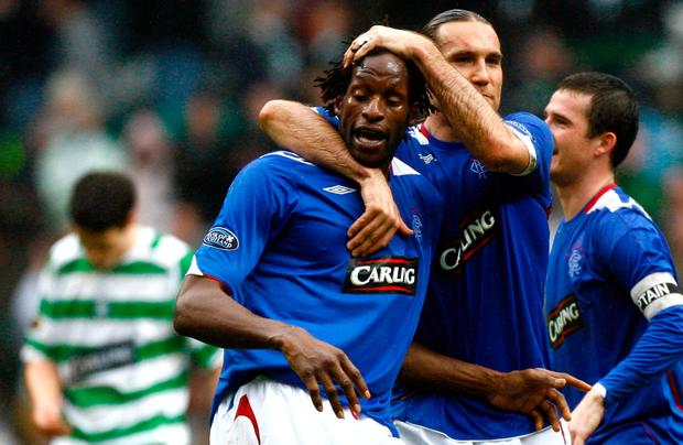Dado Prso embraces Ugo Ehiogu of Rangers at the end of the Scottish Premier League match between Celtic and Rangers at Celtic Park on March 11 2007 in Glasgow