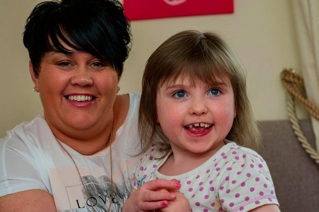 Douglas O'Connor. Lynn Marie and Jessica (9) Walsh. Jessica has received a Toby Gaze machine to help her communicate.