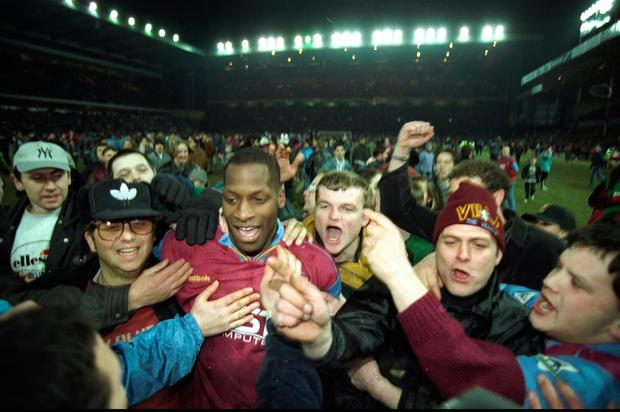 Ugo Ehiogu of Aston Villa is surrounded by fans after the Coca Cola Cup semi-final against Arsenal at Villa Park in 1996