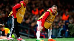 Manchester United's Wayne Rooney and Ashley Young warm up