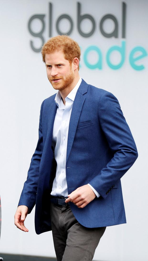Britain's Prince Harry leaves after opening the Global Academy, a state school funded by a broadcasting group to train young people for careers in the media industry, in Hayes, near London, April 20, 2017. REUTERS/John Sibley