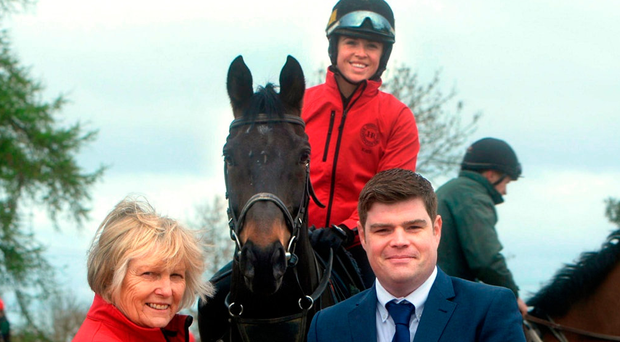 Jessica Harrington is presented with the Philips Lighting Sports Manager award for March by Dave Murphy (Philips) with Sizing John and Kate Harrington on board