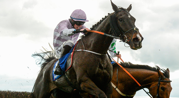 Bless The Wings, with Jack Kennedy up, clear the last during the Boylesports Irish Grand National Steeplechase during the Fairyhouse Easter Festival. Photo: Cody Glenn/Sportsfile