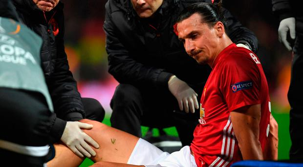 An injured Zlatan Ibrahimovic of Manchester United is given assistance during the UEFA Europa League quarter final second leg match between Manchester United and RSC Anderlecht. Photo: Getty