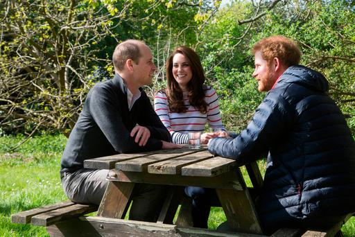 Prince William, Kate and Prince Harry in a still from the video. Photo: PA