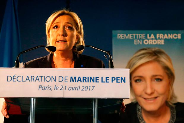 Far-right leader and candidate for the presidential election Marine Le Pen speaks in Paris yesterday, after the attack that killed one police officer and wounded three other people on the Champs-Elysées on Thursday night. Photo: Michel Euler/AP