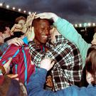 Ugo Ehiogu being mobbed by Aston Villa fans in 1994. Photo: David Jones/PA Wire