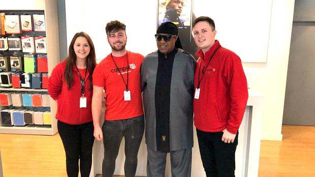 American music legend Stevie Wonder with staff at the CompuB shop in Galway yesterday ahead of his performance at the wedding today