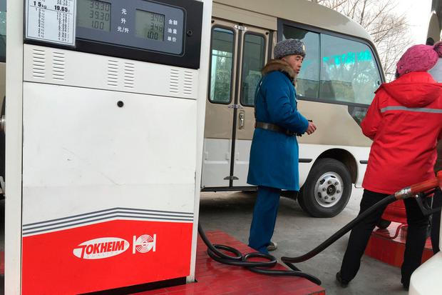 Customer talks to a gas station attendant in Pyongyang, North Korea. (AP Photo/Eric Talmadge, File)