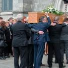 The coffin of musician Pat Fitzpatrick is taken into the chapel at Mt. Jerome crematorium. Photo: Tony Gavin 22/4/2107