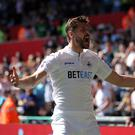 SWANSEA, WALES - APRIL 22: Fernando Llorente of Swansea City celebrates his opening goal during the Premier League match between Swansea City and Stoke City at The Liberty Stadium on April 22, 2017 in Swansea, Wales. (Photo by Athena Pictures/Getty Images)