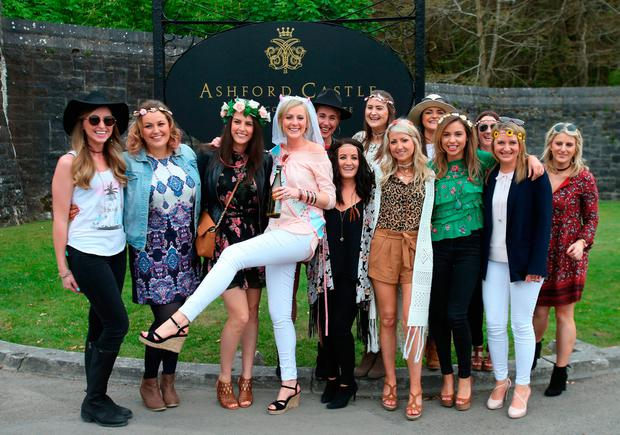 Bride to be Aiofe Power (centre white jeans) stops with her hen party outside Ashford Castle in Co Mayo, where Golf star Rory McIlroy and fiancee Erica Stoll are anticipated to get married. PRESS ASSOCIATION Photo.