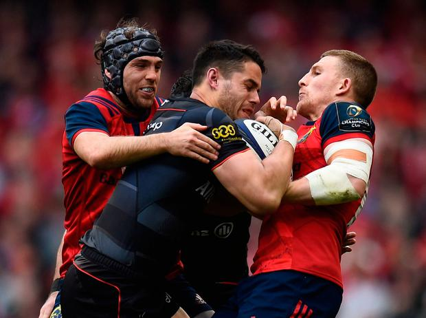 Munster's Duncan Williams and Andrew Conway compete for possession against Saracens' Sean Maitland. Photo: Reuters