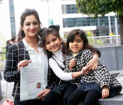 Maria Navaed with her daughters Rannaya (7) and Sarina (5) at the citizenship ceremony Photo: Sam Boal/Rollingnews.ie
