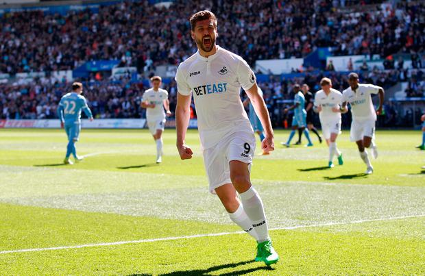 Swansea City's Fernando Llorente celebrates scoring their first goal. Photo: Reuters