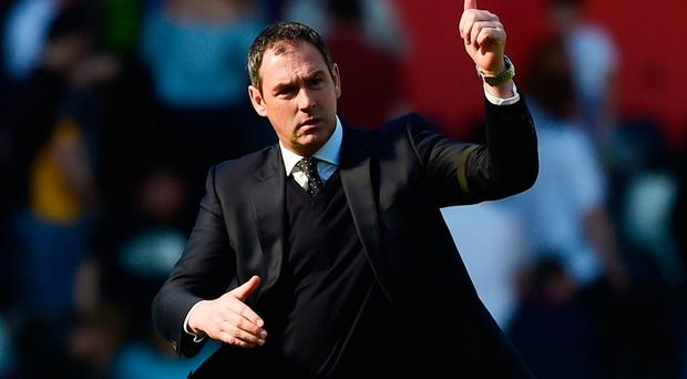 Swansea City manager Paul Clement celebrates at the end of the match. Photo: Reuters