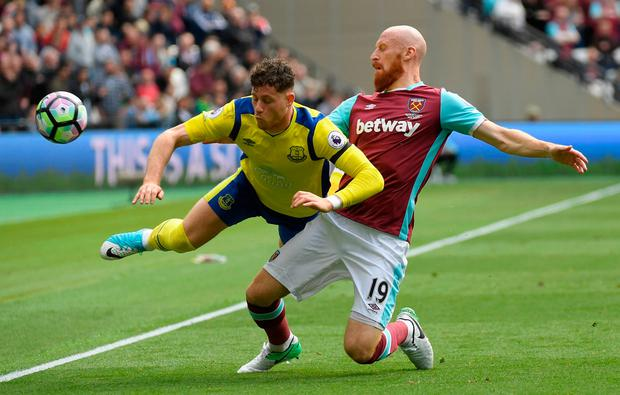 West Ham United's James Collins in action with Everton's Ross Barkley. Photo: Reuters