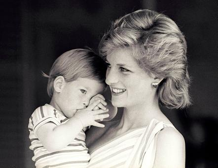 Buried grief: Prince Harry as a young boy with Diana. Now he has spoken for the first time about how he 'shut down all his emotions' after the death of his mother nearly 20 years ago. He revealed last week that he avoided dealing with his pain for nearly two decades and only recently sought professional help Photo: REUTERS/Hugh Peralta/File Photo