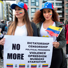 Words of warning: Venezuelan protesters Leidy Corredor and Dorielis Perez holding a placard denouncing President Nicolas Maduro at a rally held in the Smithfield area of Dublin last week Photo: Fergal Phillips