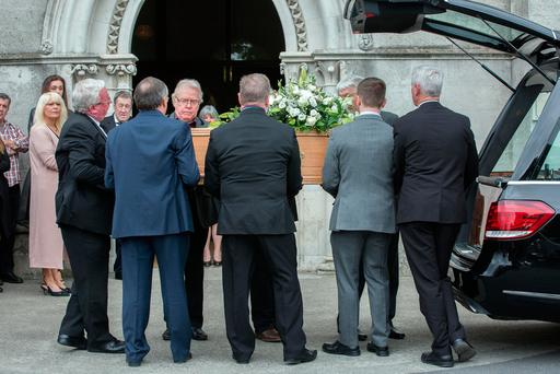 The coffin of much-loved musician Pat Fitzpatrick is taken into the chapel at Mount Jerome crematorium Photo: Tony Gavin