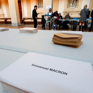 Ballot envelopes and ballot papers are seen on a table at a polling station in the first round of 2017 French presidential election in Lyon, France, April 23, 2017. REUTERS/Robert Pratta