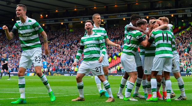 Scott Sinclair (2nd R) of Celtic celebrates scoring his side's second goal with his team mates during the Scottish Cup Semi-Final match between Celtic and Rangers at Hampden Park on April 23, 2017 in Glasgow, Scotland. (Photo by Mark Runnacles/Getty Images)