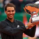 Rafael Nadal of Spain celebrates with the winners trophy after defeating Albert Ramos-Vinolas of Spain in the final during day eight of the ATP Monte Carlo Rolex Masters Tennis at Monte-Carlo Sporting Club on April 23, 2017 in Monte-Carlo, Monaco. (Photo by fotopress/Getty Images)