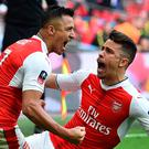 Arsenal's Chilean striker Alexis Sanchez (L) celebrates scoring their second goal with Arsenal's Brazilian defender Gabriel during the FA Cup semi-final football match between Arsenal and Manchester City at Wembley stadium in London on April 23, 2017. / AFP PHOTO / Glyn KIRK / NOT FOR MARKETING OR ADVERTISING USE / RESTRICTED TO EDITORIAL USE GLYN KIRK/AFP/Getty Images