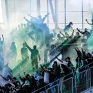 TOPSHOT - Saint-Etienne's fans invade the stadium during the French L1 football match played behind closed door between AS Saint-Etienne and Stade Rennais FC, on April 23, 2017 at the Geoffroy Guichard stadium in Saint-Etienne, central France. / AFP PHOTO / PHILIPPE DESMAZESPHILIPPE DESMAZES/AFP/Getty Images