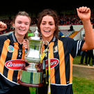 Kilkenny's Michelle Teehan, left, and captain Meighan Farrell celebrate with the cup after victory against Cork at the Gaelic Grounds. Photo: Diarmuid Greene/Sportsfile