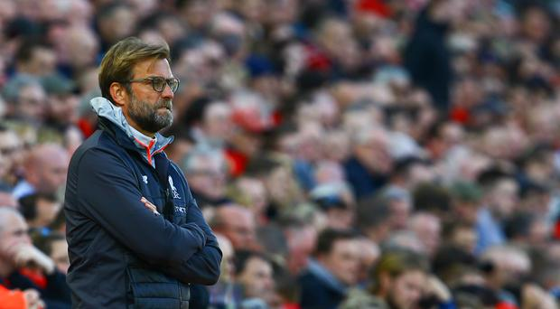 Liverpool's German manager Jurgen Klopp gestures on the touchline during the English Premier League football match between Liverpool and Crystal Palace at Anfield in Liverpool, north west England on April 23, 2017. / AFP PHOTO / Geoff CADDICK / Getty Images