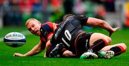 Keith Earls is tackled by Saracen's Owen Farrell. Photo: RAMSEY CARDY/SPORTSFILE