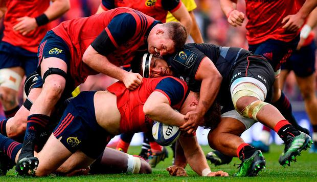 Stephen Archer is tackled by Mako Vunipola of Saracens. Photo: Ramsey Cardy/Sportsfile