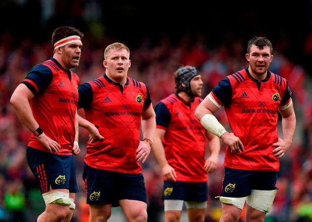 Munster players Billy Holland, John Ryan, Duncan Williams and Peter O'Mahony look on after the final whistle. Photo: Diarmuid Greene/Sportsfile