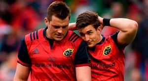 CJ Stander and Ian Keatley leave the pitch after Munster's defeat against Saracens at the Aviva Stadium. Photo: DIARMUID GREENE/SPORTSFILE