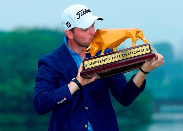 Bernd Wiesberger of Austria kisses the trophy after winning the Shenzhen International golf tournament in China. Photo: AFP/Getty Images