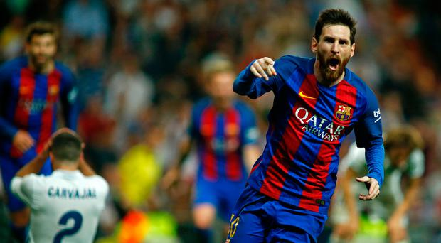 Barcelona's Argentinian forward Lionel Messi celebrates Barcelona's third goal during the Spanish league football match Real Madrid CF vs FC Barcelona at the Santiago Bernabeu stadium in Madrid on April 23, 2017. / AFP PHOTO / OSCAR DEL POZOOSCAR DEL POZO/AFP/Getty Images