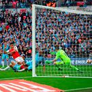 Alexis Sanchez strikes to score the winning goal for Arsenal at Wembley yesterday. Photo: PA