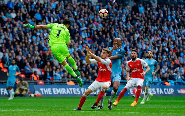 Manchester City goalkeeper Claudio Bravo rushes off his line to head the ball clear. Photo: Reuters