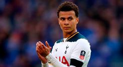 Tottenham Hotspur's Dele Alli applauds supporters after the final whistle during the Emirates FA Cup, Semi-Final match at Wembley Stadium, London. Photo: PA