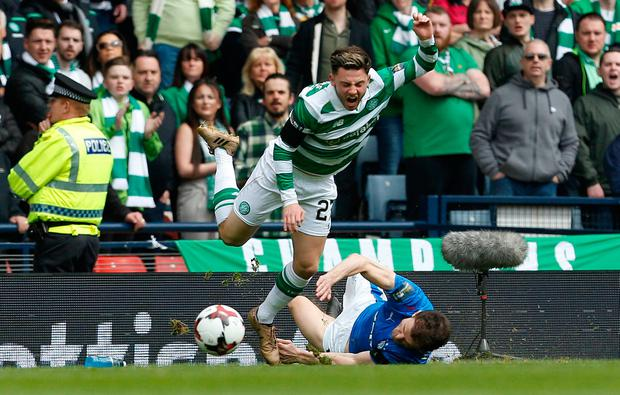 Celtic's Patrick Roberts feels the full brunt of a challenge. Photo: Reuters