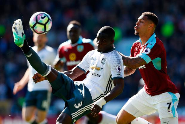 Eric Bailly clears the ball under pressure from Burnley's Andre Gray. Photo: REUTERS