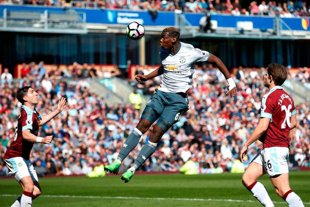 Manchester United's Paul Pogba attempts to head at goal. Photo: REUTERS