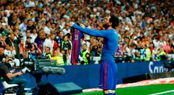 Lionel Messi shows his name and number to the fans after scoring a late winner against Real Madrid at the Santiago Bernabeu. Photo: AFP/Getty Images
