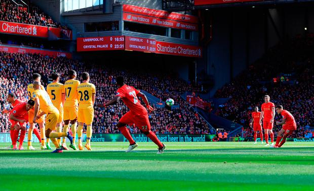 Philippe Coutinho gives Liverpool the lead from a freekick. Photo: PA