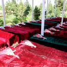 Coffins containing the bodies of Afghan national Army (ANA) soldiers killed in April 21's attack on an army headquarters are lined up in Mazar-i-Sharif, northern Afghanistan. Photo: REUTERS